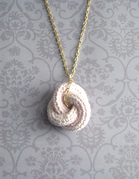 Etarnally. Crochet knot pendant in baby pink.