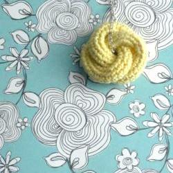 Etarnally. Crochet knot pendant in pale yellow